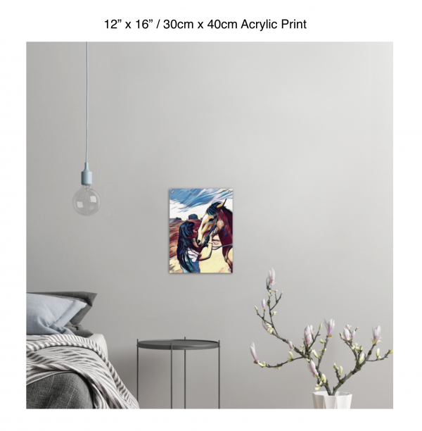 12 inch by 16 inch acrylic print of a woman kissing a horse on the nose in front of a desert background hung on the wall above a metal table next to a bed