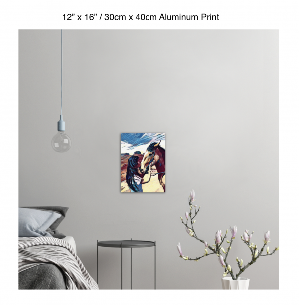 12 inch by 16 inch aluminum print of a woman kissing a horse on the nose in front of a desert background hung on the wall above a metal table next to a bed