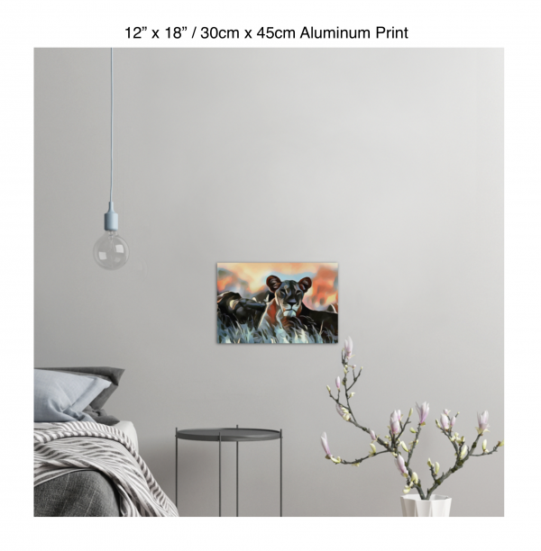 18 inch by 12 inch aluminum print of a lioness hanging in a bedroom over a night table next to a small table with a plant