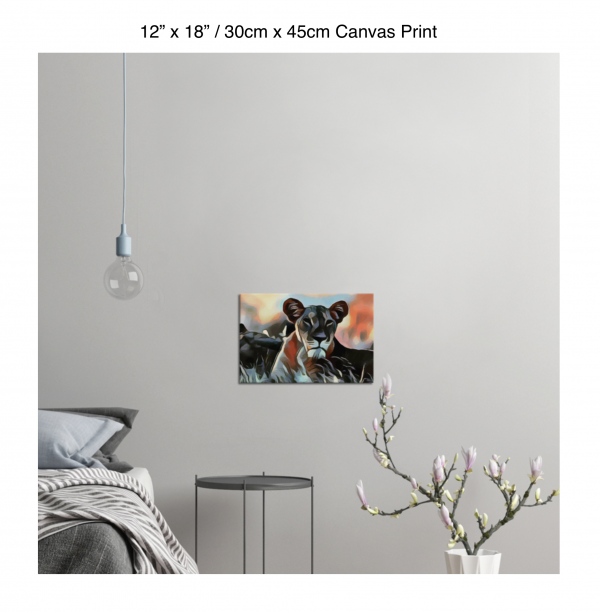 18 inch by 12 inch canvas print of a lioness hanging in a bedroom over a night table next to a small table with a plant