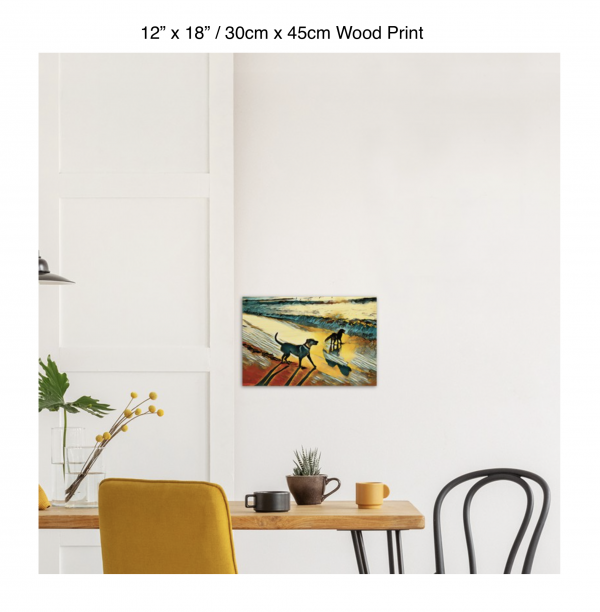 18 inch by 12 inch wood print of two dogs wading in the surf in golden tones of a sunset hung above a kitchen table