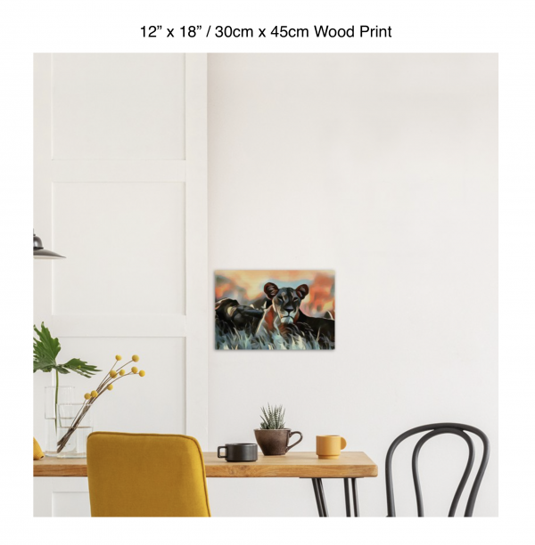 18 inch by 12 inch wood print of a lioness hanging over a dining table