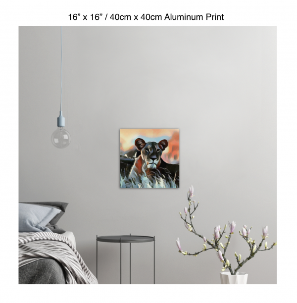 16 inch by 16 inch aluminum print of a lioness hanging in a bedroom over a night table next to a small table with a plant