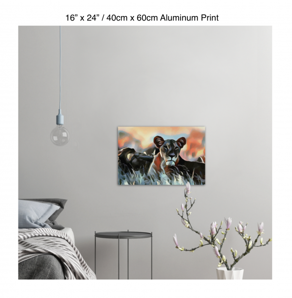 24 inch by 16 inch aluminum print of a lioness hanging in a bedroom over a night table next to a small table with a plant