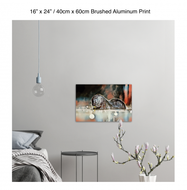 24 inch by 16 inch brushed aluminum print of an otter hanging in a bedroom over a night table next to a small table with a plant