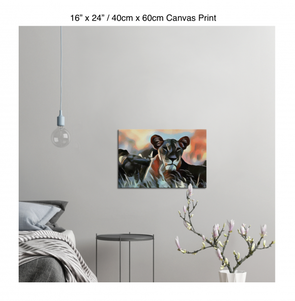 24 inch by 16 inch canvas print of a lioness hanging in a bedroom over a night table next to a small table with a plant
