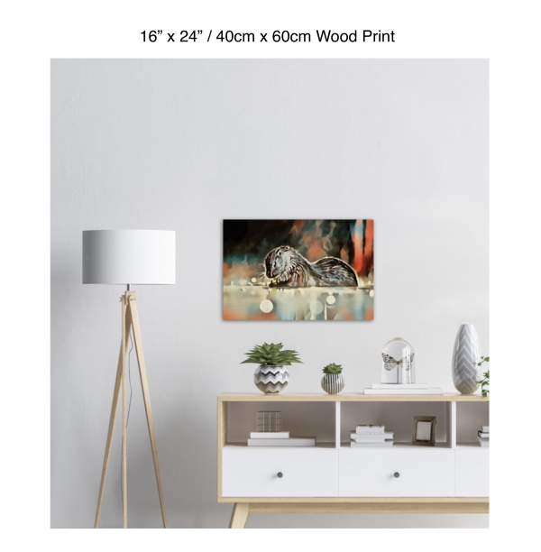 24 inch by 16 inch wood print of an otter hanging over a white credenza next to a white floor lamp