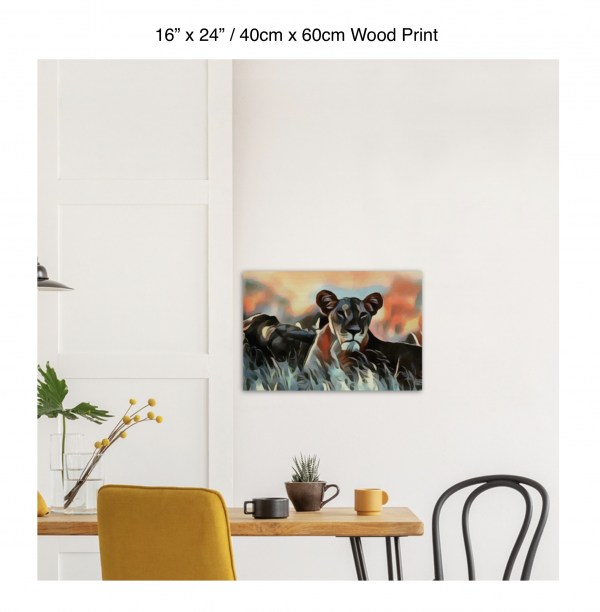 24 inch by 16 inch wood print of a lioness hanging over a dining table