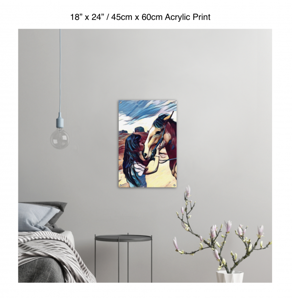 18 inch by 28 inch acrylic print of a woman kissing a horse on the nose in front of a desert background hung on the wall above a metal table next to a bed
