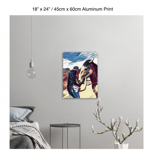 18 inch by 24 inch aluminum print of a woman kissing a horse on the nose in front of a desert background hung on the wall above a metal table next to a bed