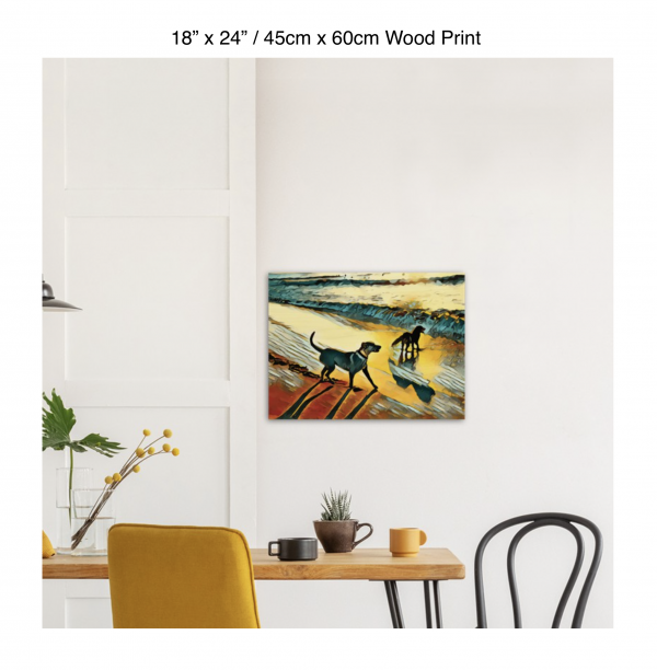 24 inch by 18 inch wood print of two dogs wading in the surf in golden tones of a sunset hung above a kitchen table