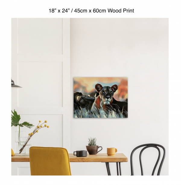 24 inch by 18 inch wood print of a lioness hanging over a dining table