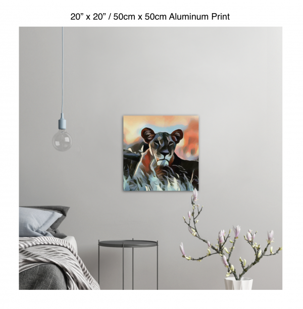20 inch by 20 inch aluminum print of a lioness hanging in a bedroom over a night table next to a small table with a plant