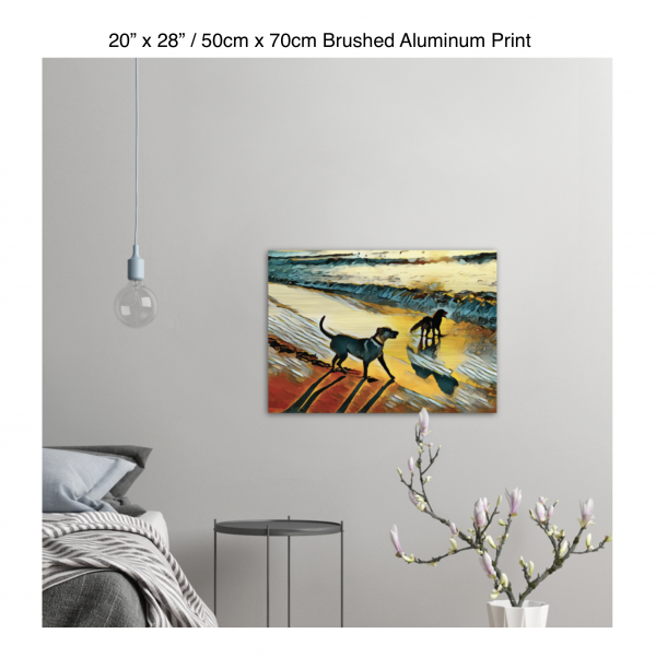 28 inch by 20 inch brushed aluminum print of two dogs wading in the surf in golden tones of a sunset hung on the wall above a metal table next to a bed