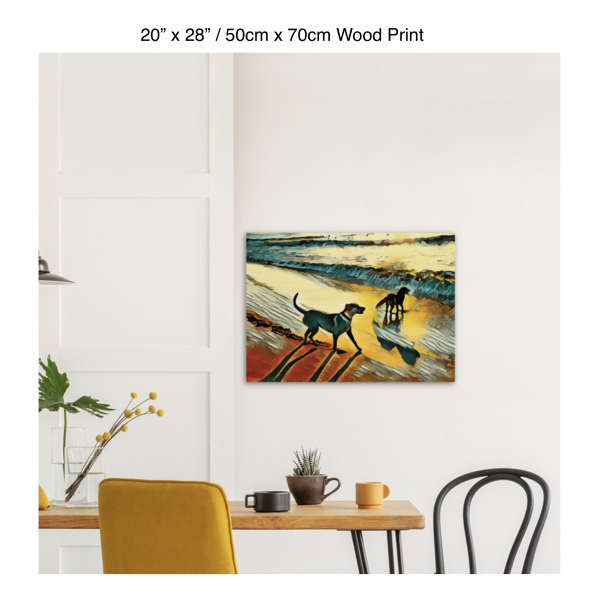 28 inch by 20 inch wood print of two dogs wading in the surf in golden tones of a sunset hung above a kitchen table