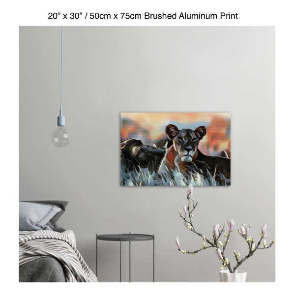 30 inch by 20 inch brushed aluminum print of a lioness hanging in a bedroom over a night table next to a small table with a plant