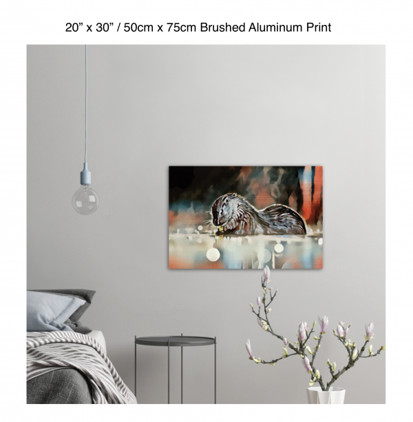 30 inch by 20 inch brushed aluminum print of an otter hanging in a bedroom over a night table next to a small table with a plant