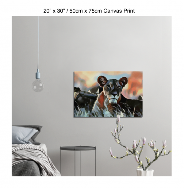 30 inch by 20 inch canvas print of a lioness hanging in a bedroom over a night table next to a small table with a plant