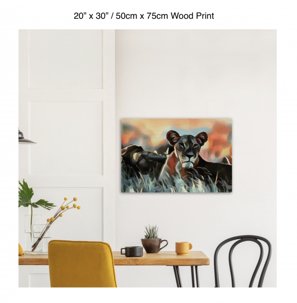 30 inch by 20 inch wood print of a lioness hanging over a dining table