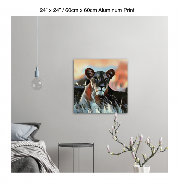 24 inch by 24 inch aluminum print of a lioness hanging in a bedroom over a night table next to a small table with a plant
