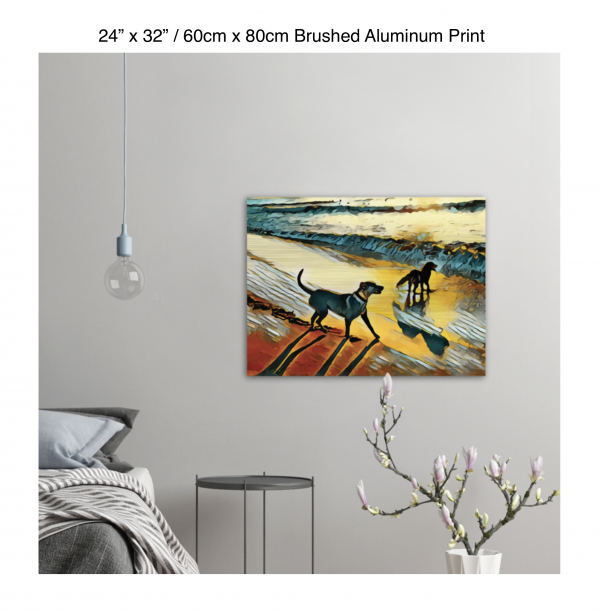 32 inch by 24 inch brushed aluminum print of two dogs wading in the surf in golden tones of a sunset hung on the wall above a metal table next to a bed