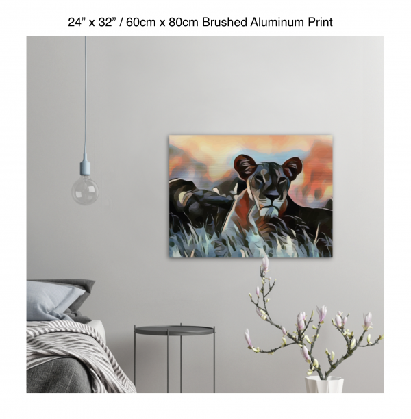 32 inch by 24 inch brushed aluminum print of a lioness hanging in a bedroom over a night table next to a small table with a plant