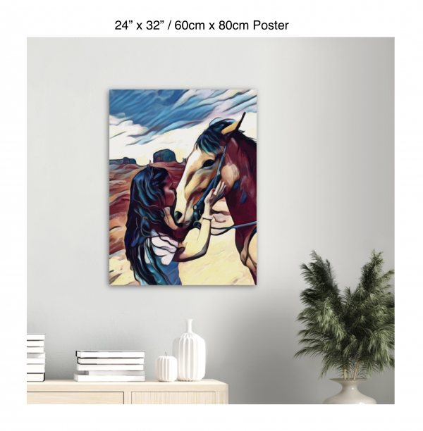 24 inch by 32 inch poster of a woman kissing a horse on the nose in front of a desert background hung above a table