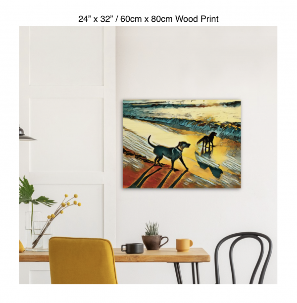 32 inch by 24 inch wood print of two dogs wading in the surf in golden tones of a sunset hung above a kitchen table