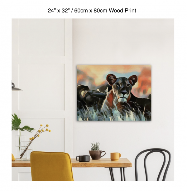 24 inch by 32 inch wood print of a lioness hanging over a dining table