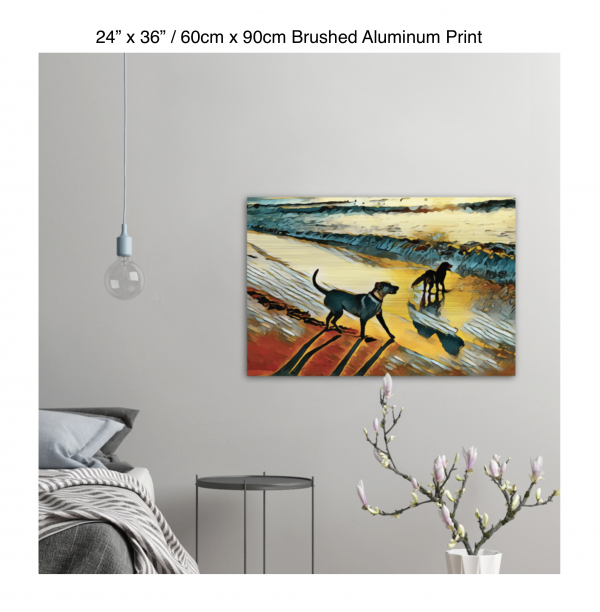 36 inch by 24 inch brushed aluminum print of two dogs wading in the surf in golden tones of a sunset hung on the wall above a metal table next to a bed