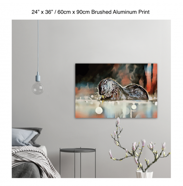36 inch by 24 inch brushed aluminum print of an otter hanging in a bedroom over a night table next to a small table with a plant