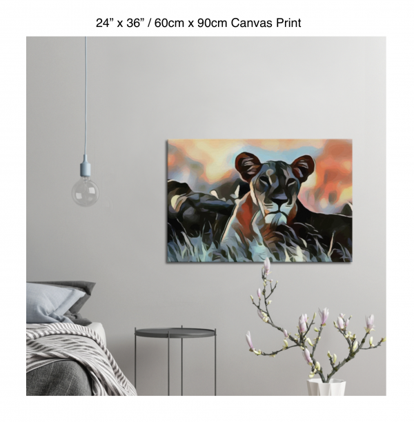36 inch by 24 inch canvas print of a lioness hanging in a bedroom over a night table next to a small table with a plant