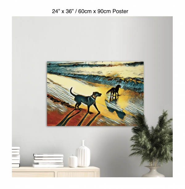 36 inch by 24 inch poster print of two dogs wading in the surf in golden tones of a sunset hanging over a bookshelf next to a plant