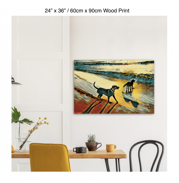 36 inch by 24 inch wood print of two dogs wading in the surf in golden tones of a sunset hung above a kitchen table