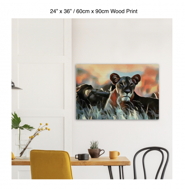 36 inch by 24 inch wood print of a lioness hanging over a dining table