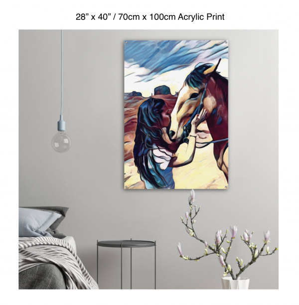 28 inch by 40 inch acrylic print of a woman kissing a horse on the nose in front of a desert background hung on the wall above a metal table next to a bed