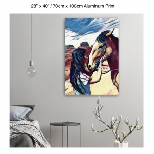 28 inch by 40 inch aluminum print of a woman kissing a horse on the nose in front of a desert background hung on the wall above a metal table next to a bed