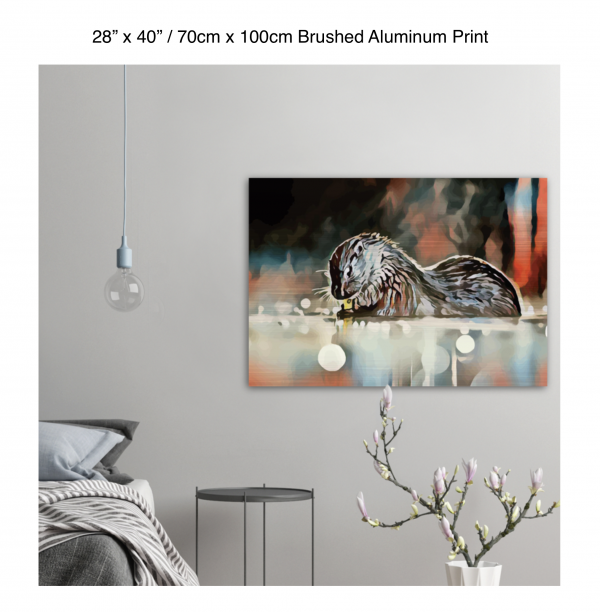 40 inch by 28 inch brushed aluminum print of an otter hanging in a bedroom over a night table next to a small table with a plant
