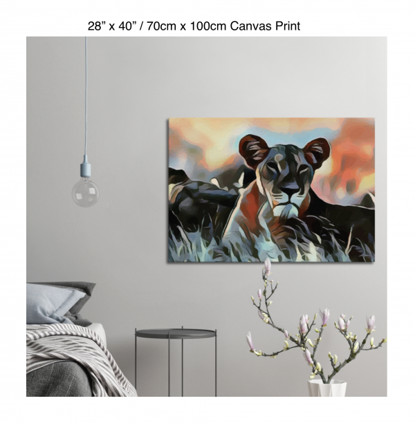 40 inch by 28 inch canvas print of a lioness hanging in a bedroom over a night table next to a small table with a plant