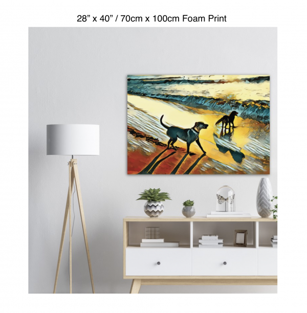 40 inch by 28 inch foam print of two dogs wading in the surf in golden tones of a sunset hanging over a credenza next to a floor lamp