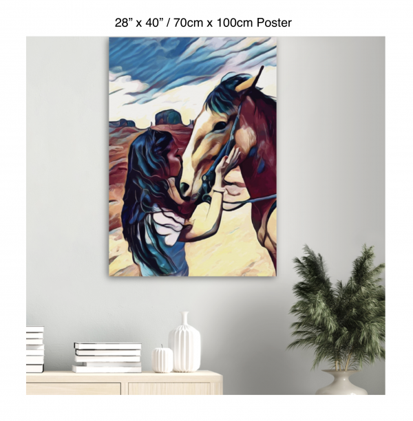 28 inch by 40 inch poster of a woman kissing a horse on the nose in front of a desert background hung above a table