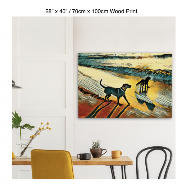 40 inch by 28 inch wood print of two dogs wading in the surf in golden tones of a sunset hung above a kitchen table