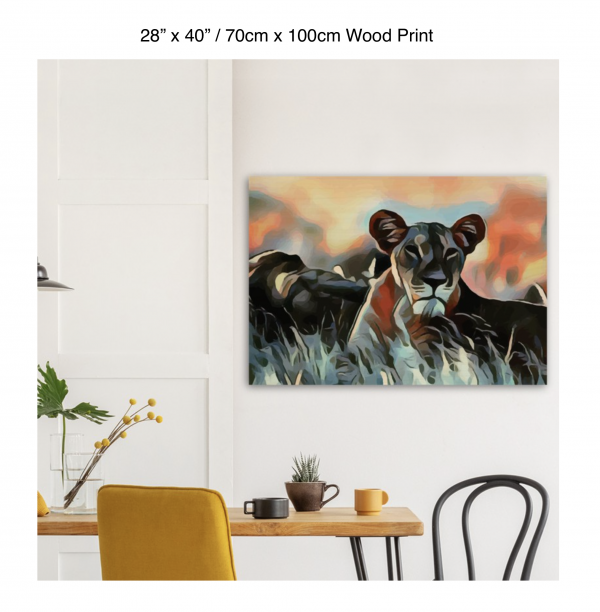 40 inch by 28 inch wood print of a lioness hanging over a dining table