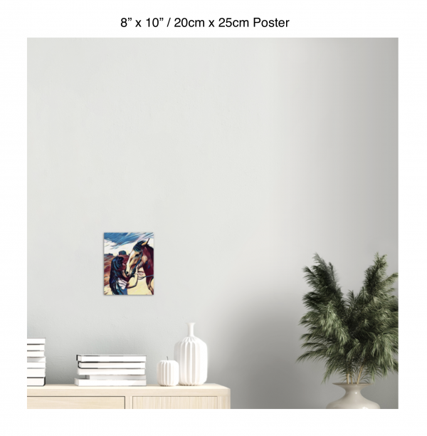 8 inch by 10 inch poster of a woman kissing a horse on the nose in front of a desert background hung above a table