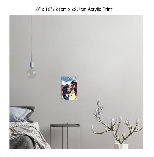 8 inch by 12 inch acrylic print of a woman kissing a horse on the nose in front of a desert background hung on the wall above a metal table next to a bed