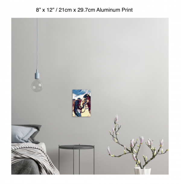 8 inch by 12 inch aluminum print of a woman kissing a horse on the nose in front of a desert background hung on the wall above a metal table next to a bed