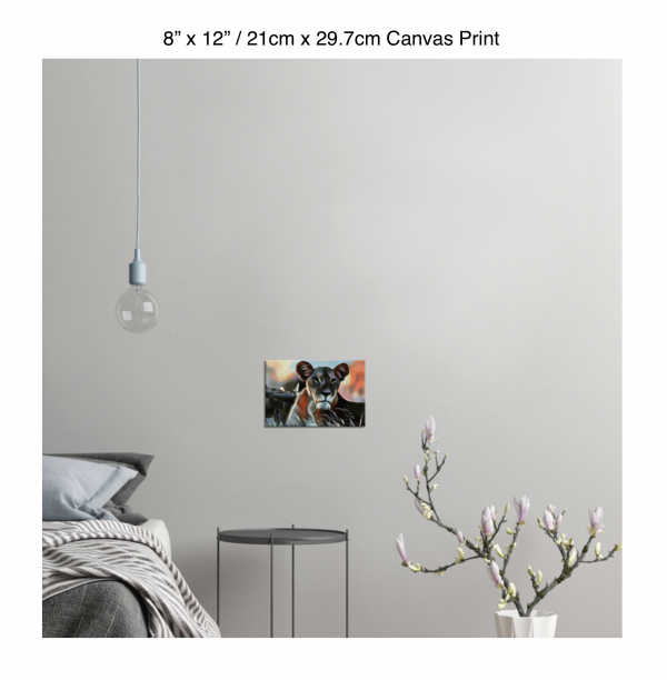 12 inch by 8 inch canvas print of a lioness hanging in a bedroom over a night table next to a small table with a plant