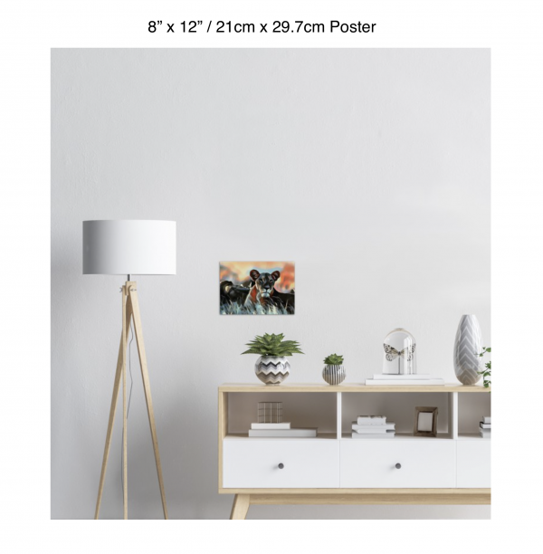 12 inch by 8 inch poster of a lioness hanging over a white credenza next to a white floor lamp