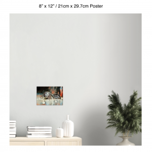 12 inch by 8 inch poster of an otter hanging over a bookshelf next to a plant