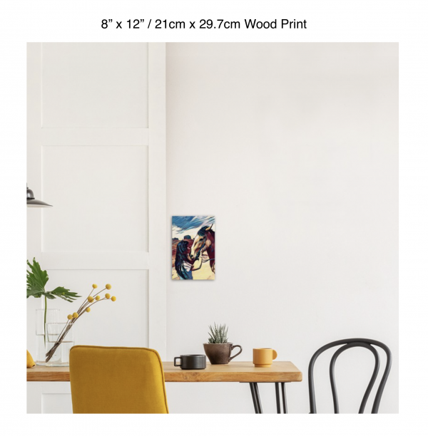 8 inch by 12 inch wood print of a woman kissing the nose of a horse hung above a kitchen table